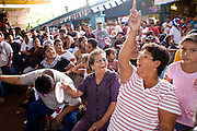 July 13, 2008 -- PHOENIX, AZ: Lucha Libre fans cheer during a show at El Gran Mercado in Phoenix. Lucha Libre is Mexican style wrestling. There are heros (Tecnicos) and villians (Rudos). The masks are popular as children's gifts and tourist mementos. As the size of the Mexican community in the Phoenix area has grown, attendance at the Lucha Libre shows has increased. Lucha Libre differs from American style entertainment wrestling in several ways, but principally the wrestlers are more acrobatic and rely less on body slams than American wrestling. The shows, which used to be held only periodically, are now held every week at El Gran Mercado, a flea market and swap meet that caters mostly to the Mexican community in Phoenix.   Photo by Jack Kurtz / ZUMA Press