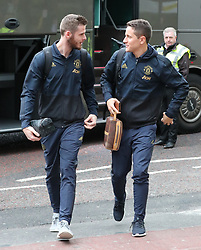 Ander Herrera and David De Gea are spotted on their way to catch a flight as the team fly to Turin on Tuesday afternoon to play Juventus in The Champions League on Wednesday night.