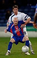 Photo: Daniel Hambury.<br />Crystal Palace v Preston North End. The FA Cup. 07/02/2006.<br />Palace's Andrew Johnson and Preston's Chris Lucketti battle for the ball.