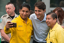 Prime Minister Justin Trudeau, third left, poses for a selfie with Alfredo Nolasco, right, Fire Handling Manager of MexicoÕs National Forest Commission (CONAFOR), and Miguel Campos, front left, a representative of CONAFOR, during a visit to the Prince George Fire Centre, in Prince George, B.C., on Thursday August 23, 2018. Photo by Darryl Dyck/CP/ABACAPRESS.COM