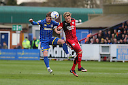 former Crawley Town Football Club player Dannie Bulman midfielder of AFC Wimbledon (4) tussles with Crawley Town Forward Lee Barnard (9) during the Sky Bet League 2 match between AFC Wimbledon and Crawley Town at the Cherry Red Records Stadium, Kingston, England on 16 April 2016. Photo by Stuart Butcher.
