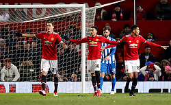 Manchester United's (left-right) Nemanja Matic, Jesse Lingard and Chris Smalling appeal during the Emirates FA Cup, quarter final match at Old Trafford, Manchester.