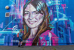 Edinburgh Science Festival, Edinburgh, Scotland, United Kingdom: <br /> Pictured: Edie Lamont, aged 7 years, admires the portrait by graffiti and mural artist Shona Hardie of Natalie Duffield, one of the artworks in a street art trail called 'Women in STEM' which showcases the achievements of nine women who have contributed to the world of Science, Technology, Engineering and Maths (STEM). Natalie Duffield is CEO of InTechnology SmartCitie, a company that provides free WiFi in central Edinburgh. Shona has also painted many of the other portraits in the trail which are displayed in venues across the city. <br /> The 2021 Edinburgh Science Festival runs from 26 June – 11 July.<br /> Sally Anderson | EdinburghElitemedia.co.uk