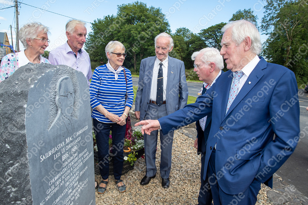 Memebrs of the Fleadh Cheoil na Mumhan and Family members unveil the plaque in memory of Sylvester Conway in Lissycasey on Sunday
