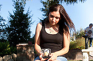 Cheri Le joined the Mothers of an Angel Friendship Network after her six year old daughter died. I photographed Cheri in Martha Tessmer's backyard with a rose Cheri's daughter gave Cheri. Martha started Mothers of an Angel Network after her son Donovan died. Martha Tessmer started the Mother of an Angel Friendship Network after her teenage son Donovan died in a distracted driving car accident. The support group is for mothers who have lost a child to death.