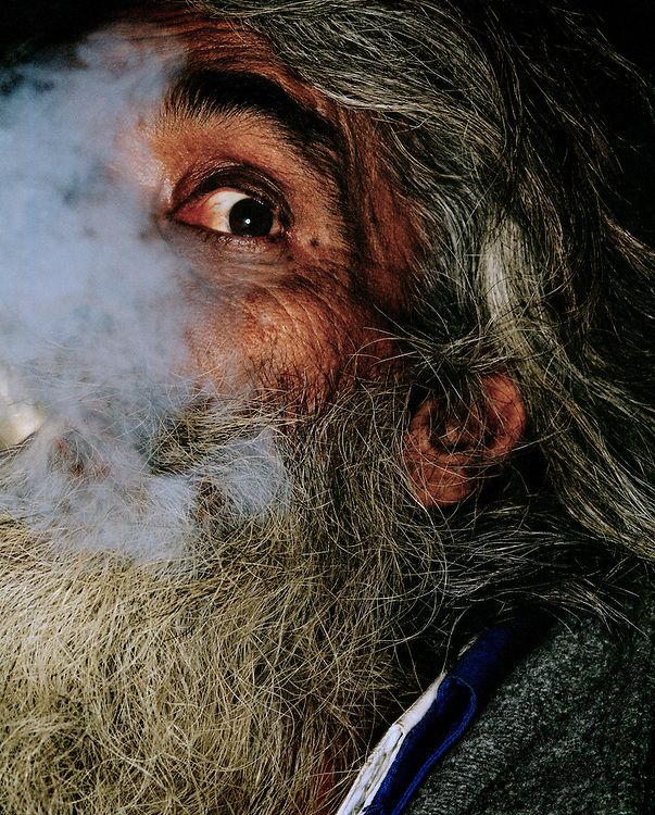 Close up portrait of a man smoking