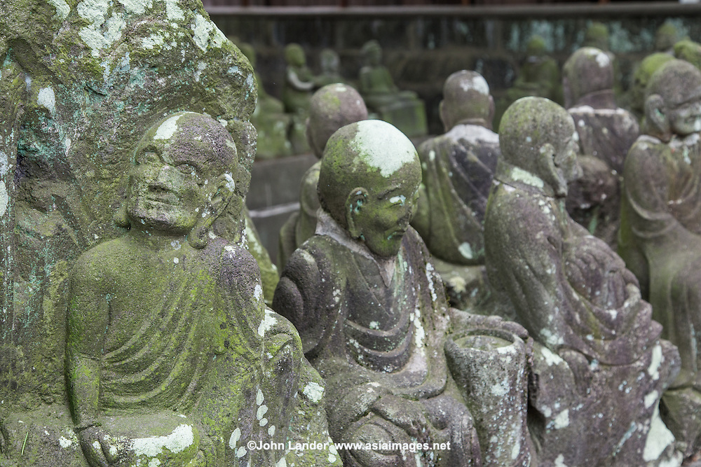 """There are 540 of these statues representing disciples of Buddha at Kitain Temple in Kawagoe. They were sculpted between 1782 and 1825.  No two rakan statues are alike.  This assemblage on the temple grounds is known as Go Kyuaku Rakan, or """"500 Rakan"""" although there are actually 540."""