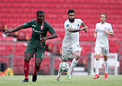 Jores Okore (AaB) følges af Michael Santos (FC København) under kampen i 3F Superligaen mellem FC København og AaB den 17. juni 2020 i Telia Parken, København (Foto: Claus Birch).