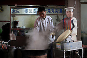 XI\'AN, CHINA - NOVEMBER 11:  China Out - Finland Out<br /> <br /> Robot Cook <br /> <br /> A robot slices noodles at a restaurant on November 11, 2013 in Xi'an, Shaanxi Province of China. The restaurant owner bought this robot with 7,000 RMB (about 1,140 USD) to substitute employees.<br /> ©Exclusivepix