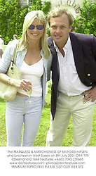 The MARQUESS & MARCHIONESS OF MILFORD-HAVEN at a luncheon in West Sussex on 8th July 2001.	ORA 179
