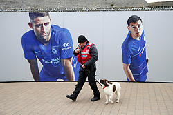 A search dog patrols outside Stamford Bridge during the Premier League match at Stamford Bridge, London.