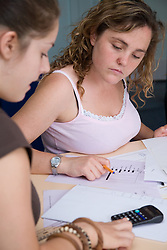Young women working in a numeracy and literacy class at the Aspire Training Scheme for young mothers and mothers to be,