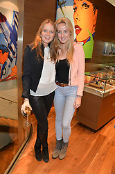 Left to right, ARABELLA HOLLAND and JEMIMA CADBURY at a party to celebrate the 30th Anniversary of the Breitling Chronomat held at 130 Breitling, New Bond Street, London on 7th May 2014.