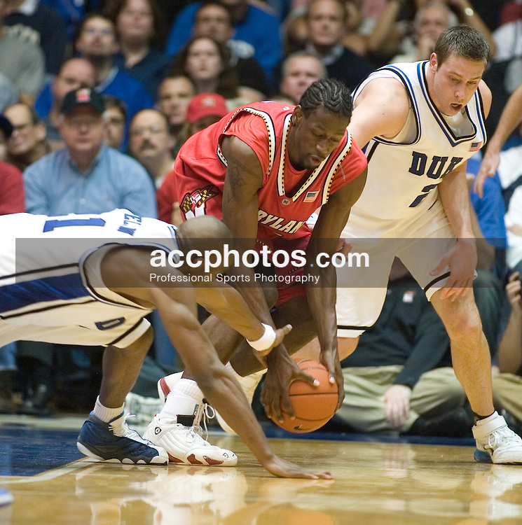 Feb. 28, 2007; Durham, NC, USA; Duke Blue Devils guard DeMarcus Nelson (21) and forward Josh McRoberts (2) fight for possession with Maryland Terrapins forward James Gist (15) at Cameron Indoor Stadium in a 77-85 Maryland win in Durham, NC.