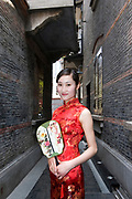 SHANGHAI, CHINA - April 18: CHEN Nana, a hostess for GL events, poses for a photograph in Xintiandi neighborhood on April 18, 2010 in Shanghai, China. Chen Nana is 22-year-old and comes from Anhui province in China. (Photo by Lucas Schifres/Getty Images)