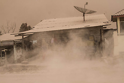 August 2, 2017 - Karo, North Sumatra, Indonesia - Volcanic dust covered villages when Sinabung volcano releases pyroclastic flows into the air, in Karo. The volcano destroys volcanic ash as high as 4.2 kilometers (2.2 miles), one of its biggest eruptions. In recent months high activity. (Credit Image: © Ivan Damanik via ZUMA Wire)