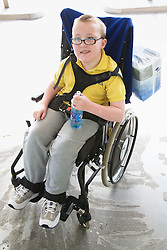 Child with cerebral palsy in a wheelchair,