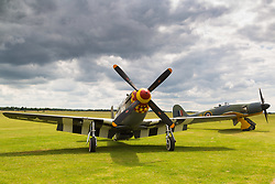 IWM Duxford, UK, July 4th 2017. North American P-51 Mustang Berlin Express rests on the airfield at IWM Duxford, following its completion of a historic transatlantic flight of 5,470 miles, flown by Lee Lauderback of the United States Air Force Heritage Flight from the United States to IWM Duxford, to take part in the Flying Legends Air Show on Saturday 8 and Sunday 9 July. The restored Berlin Express is based around the remains of P-51B 43-24837. This Mustang flew with the 9th Air Force's 363rd Fighter Group out of RAF Staplehurst in Kent. It crashed in Beckley on 10 June 1944 after the pilot was forced to bail out during a training exercise.  It wears the markings of Berlin Express and is dressed exactly like the 357th Fighter Group Mustang which Overstreet famously flew under the Eiffel Tower in 1944.