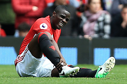 30th April 2017 - Premier League - Manchester United v Swansea City - Eric Bailly of Man Utd holds his injured ankle - Photo: Simon Stacpoole / Offside.