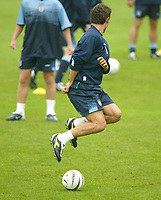 Photo Aidan Ellis.<br />England training at the cliff in Manchester.<br />04/09/2003.<br />Gary Neville trys a trick in training