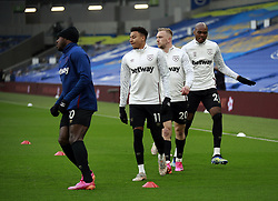 West Ham United's Michail Antonio (left), Jesse Lingard, Jarrod Bowen and Angelo Ogbonna (right) warming up prior to kick-off during the Premier League match at the American Express Community Stadium, Brighton. Picture date: Saturday May 15, 2021.