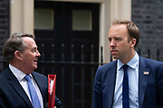 Secretary of State for International Trade Liam Fox and Health Secretary Matt Hancock speaking to each other  in Downing Street following a weekly cabinet meeting on 25th June 2019 in London, United Kingdom.