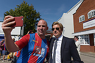 Steve Parish, the Crystal Palace Owner does a selfie with a Palace fan outside Selhurst Park before k/o. Barclays Premier league match, Crystal Palace v Aston Villa at Selhurst Park in London on Saturday 22nd August 2015.<br /> pic by John Patrick Fletcher, Andrew Orchard sports photography.