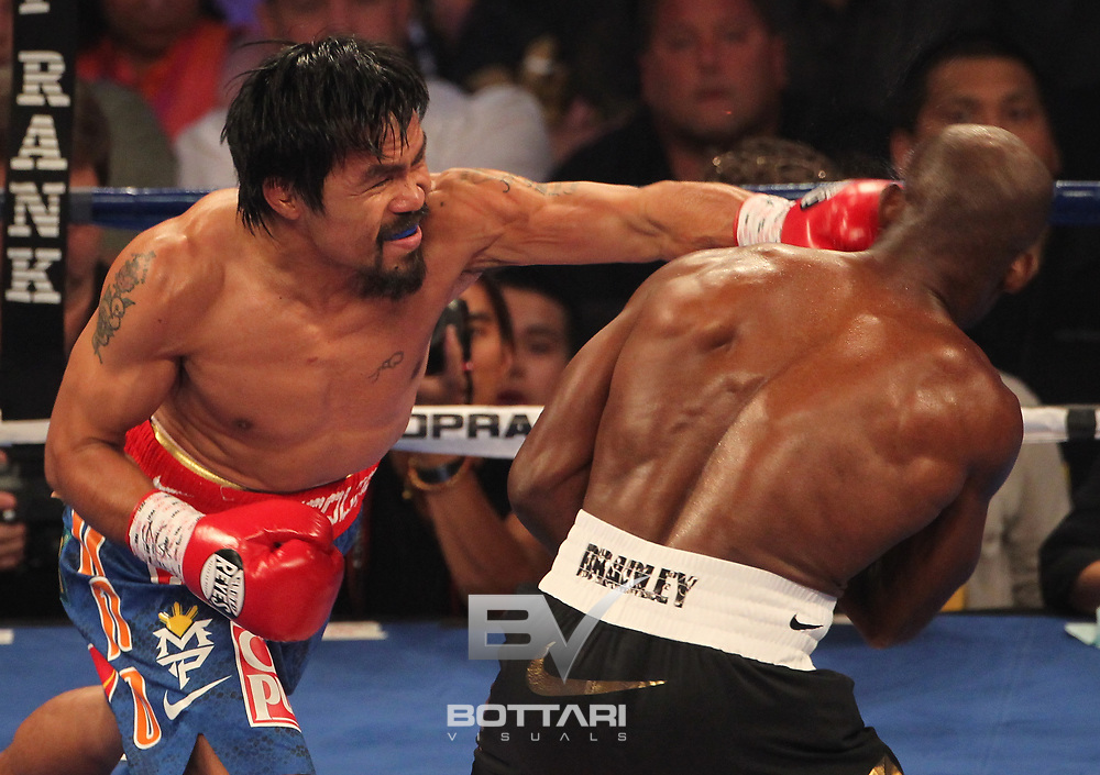 LAS VEGAS, NV - JUNE 09:  (L-R) Manny Pacquiao lands a left to the head of Timothy Bradley during their WBO welterweight title fight at MGM Grand Garden Arena on June 9, 2012 in Las Vegas, Nevada.  (Photo by Jeff Bottari/Getty Images) *** Local Caption *** Manny Pacquiao; Timothy Bradley