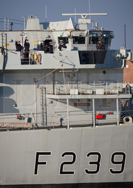 © Licensed to London News Pictures. 05/10/2016. Portsmouth, Hampshire, UK.  Crew of the Type 23 Frigate, HMS Richmond (F239), waving as they return to their home port of Portsmouth this morning, following a trip to Den Helder in The Netherlands. The warship is believed to have been conducting routine training. Photo credit: Rob Arnold/LNP