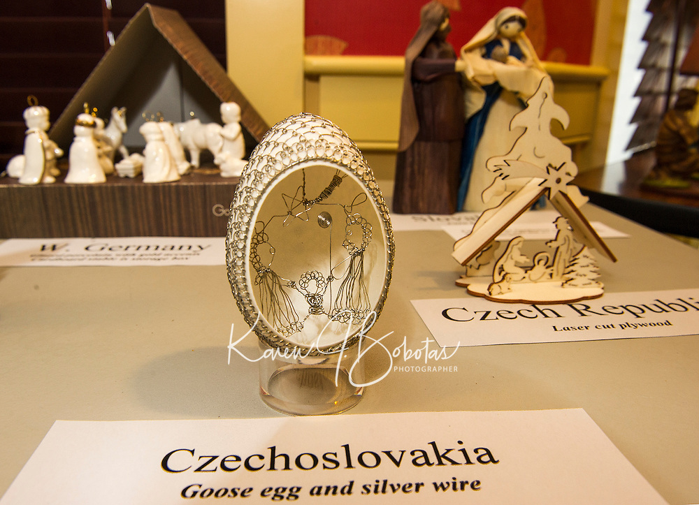 A goose egg with silver wire from Czechoslovakia and laser cut wood piece from Czech Republic are among  Rev. John Eaton's 100 nativity scenes on display at the Meredith Bay Colony Club through Sunday.  (Karen Bobotas/for the Laconia Daily Sun)