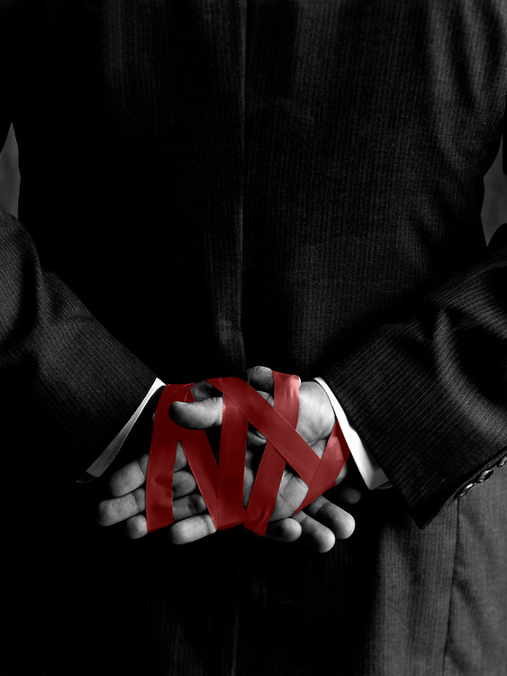 Hands tied with red tape