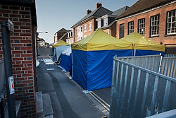 © Licensed to London News Pictures. 06/07/2018. Salisbury, UK. Plastic sheeting and tents are in place outside a hostel in Salisbury town centre after couple, named locally as Dawn Sturgess, 44, and her partner Charlie Rowley, 45, were taken ill on Saturday 30th June 2018. Police have confirmed that the couple have been in contact with Novichok nerve agent. Former Russian spy Sergei Skripal and his daughter Yulia were poisoned with Novichok nerve agent in nearby Salisbury in March 2018. Photo credit: Peter Macdiarmid/LNP