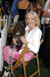 writer UNA-MARY PARKER and her dog Truffel at the Macmillan Cancer Relief Dog Day held at the Royal Hospital Chelsea South Grounds, London on 6th July 2004.