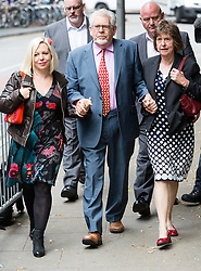 © Licensed to London News Pictures. 23/06/2014. London, UK. Artist and television personality, Rolf Harris arrives at Southwark Crown Court in London with his daughter Bindi on 23rd June 2014. Rolf Harris denies 12 counts of indecent assault against four girls and women between 1968 and 1986. Photo credit : Vickie Flores/LNP