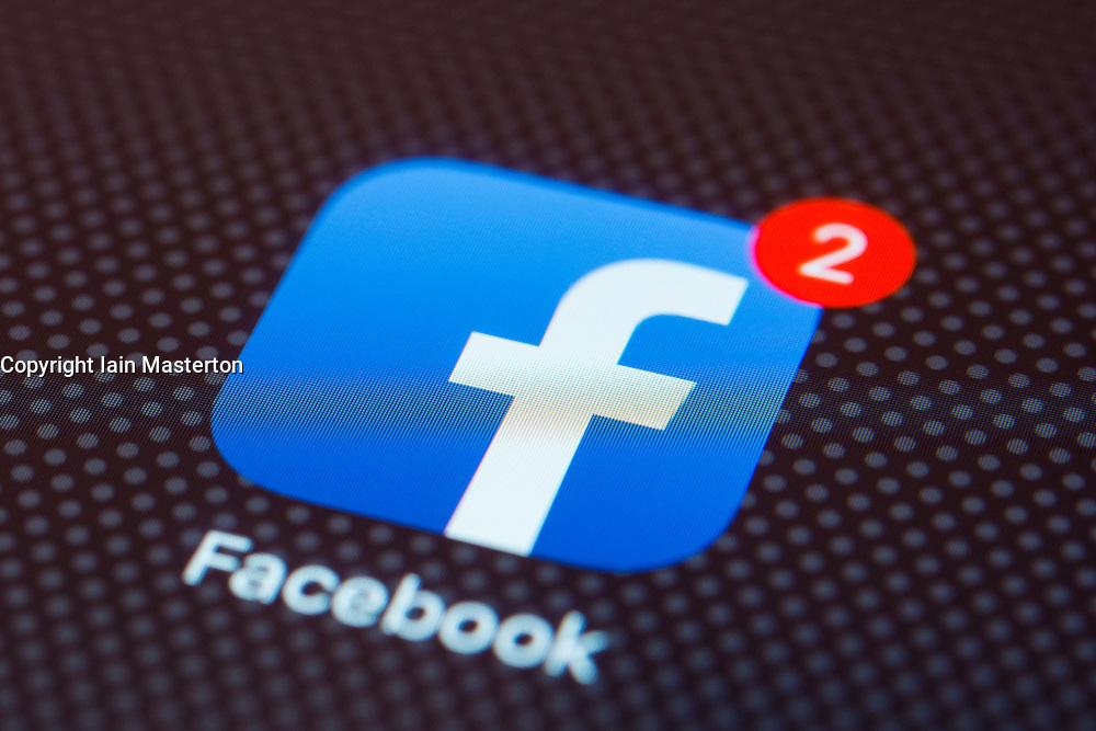 Facebook social network app close up on iPhone smart phone screen