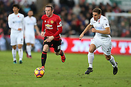 Wayne Rooney of Manchester Utd breaks away from Angel Rangel of Swansea city. Premier league match, Swansea city v Manchester Utd at the Liberty Stadium in Swansea, South Wales on Sunday 6th November 2016.<br /> pic by  Andrew Orchard, Andrew Orchard sports photography.