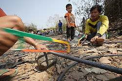 Villagers work on all aspects of the construction under the supervision of the Namsa at staff. Village Had Mad, Pak Ou district Luang Prabang Province. Lao PDR