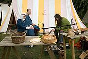 Family group eating Historical re-enactment Saxon, Viking, Norman history, Woodbridge, Suffolk
