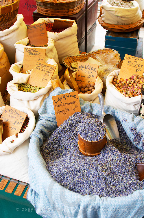 Spice seller at a market. Lavender flowers old by weight. White pepper, green pepper, and other spices. Collioure. Roussillon. France. Europe.