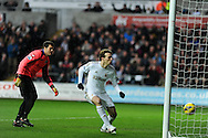 Swansea city's Michu scores the 1st goal as a helpless QPR keeper Julio Cesar looks on. Barclays Premier league, Swansea city v Queens Park Rangers at the Liberty Stadium in Swansea, South Wales on Saturday  9th Feb 2013. pic by Andrew Orchard, Andrew Orchard sports photography,