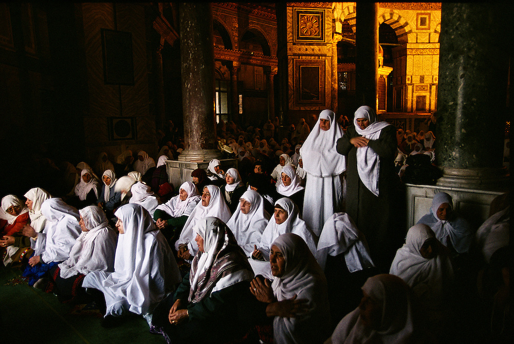 Jerusalem, Israel:  Muslim women pray inside the Dome of the Rock, at dawn on the final day of Ramadan.
