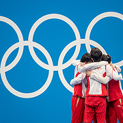 TOKYO, JAPAN - JULY 29: The world record breaking China team of Junxuan Yang, Yufei Zhang, Bingjie Li and <br />  Muhan Tang on the podium with their gold medals applauded by Katie Ledecky of the United States after their gold medal win in the 4x 200m relay for women during the Swimming Finals at the Tokyo Aquatic Centre at the Tokyo 2020 Summer Olympic Games on July 29, 2021 in Tokyo, Japan. (Photo by Tim Clayton/Corbis via Getty Images)