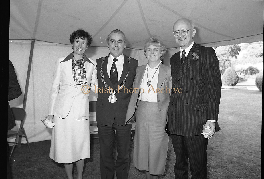 Guests and staff at the US Embassy in Phoenix Park, Dublin, celebrate American Independence Day..1980-07-04.4th July 1980.04/07/1980.07-04-80..Photographed at the US Ambassador's Residence,  Phoenix Park...Mayor of Dublin, Fergus O'Brien and his wife (centre) pose for the camera with Elizabeth McNelly Shannon  and Ambassador William V Shannon in the marquee during festivities.