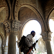 A rebel fighter takes cover from heavy shelling inside a construction site of an unfinished mosque in central Sebratha.