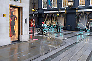 Four days before Christmas, retailers in Bond Street remain closed after the government's last-minute u-turn on the easing of Coronavirus pandemic rules. London and the South-East has been put under a Tier 4 restriction, forcing the closure of non-essential shops and small businesses, on 21st December 2020, in London, England.