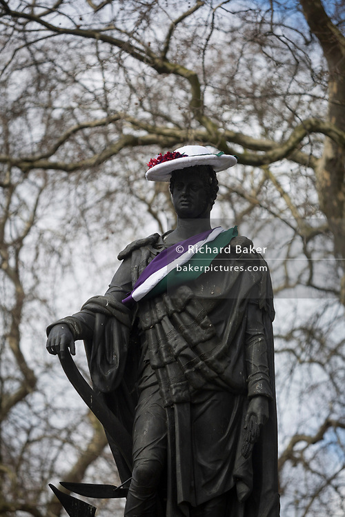 London UK, 8th March 2018: A suffragette-style sash has been draped by a womens group across the statue of Francis, Duke of Bedford on International Womens' Day, on 8th March 2018, in Russell Square, London, England. According to the group concerned about the poor representation of women commemorations, there are fewer than 3% of non-royal statues in the UK. Francis Russell, 5th Duke of Bedford (1765-1802) was an English aristocrat and Whig politician, responsible for much of the development of central Bloomsbury, London. Richard Baker / Alamy Live News
