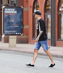 Manchester City'€™s goalkeeper Ederson is spotted wearing denim shorts in Manchester city centre on Sunday afternoon