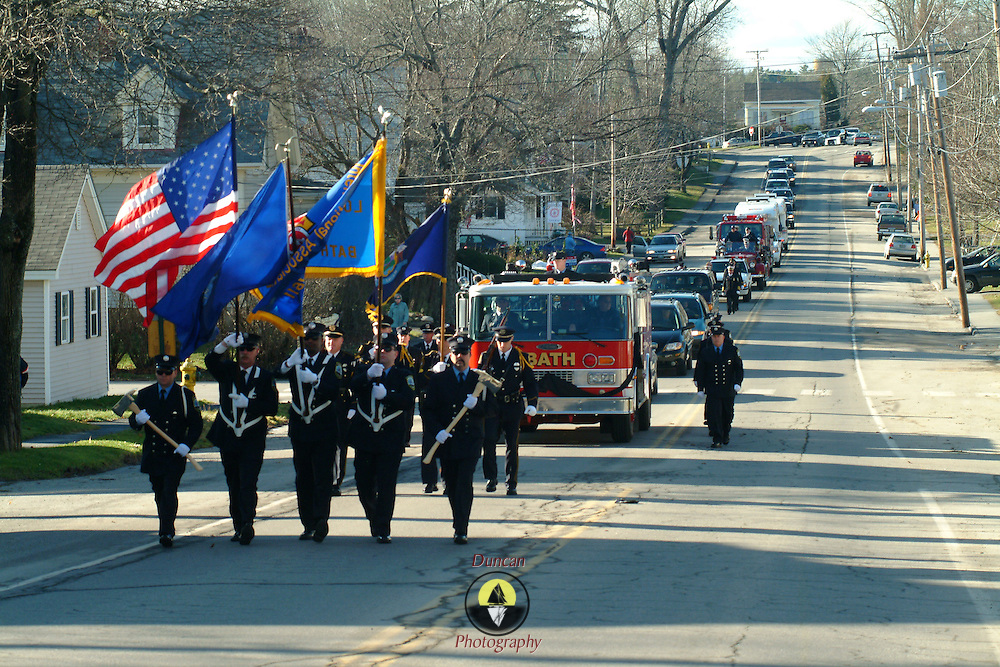 """BATH, Maine -- 12 /16/ 06 -- The funeral procession for  Bath City Councilor and Fireman John C. """"Jack"""" Hart Jr.  traveled from the Bath Middle School down North St to High St and finished at the Fire Station. Photo by Roger S. Duncan ."""