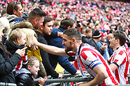 Lincoln City's Luke Waterfall celebrates with fans during the EFL Trophy Final match between Lincoln City and Shrewsbury Town at Wembley Stadium, London, England on 8 April 2018. Picture by John Potts.