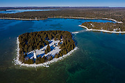 Early morning light at the Cana Island Lighthouse on Lake Michigan near Baileys Harbor, Wisconsin.